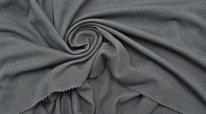 Каковы свойства ткани байки и где используется материал?