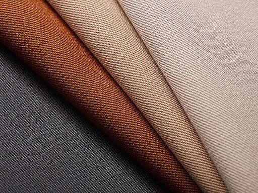 Как появились камвольные ткани и какими свойствами они славятся?